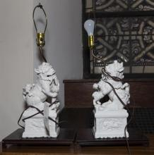 Pair of lamps featuring porcelain fu dogs