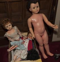 Collection of assorted dolls and doll clothing