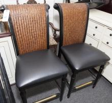 Set of four bar height chairs with wicker style backs and brass stretcher