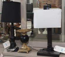 Two small table lamps and a candle holder
