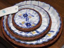Set of three nesting plates with wicker holders