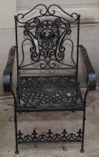 Iron folding garden chair with floral and basket weave designed seat, the back featuring a medallion with birds