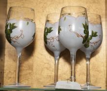 Four wine glasses with grape design
