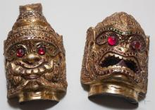 Pair of small Asian designs masks