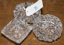 Three crystal ashtrays