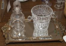 Three items including a mirrored dressing tray, decanter, and small crystal ice bucket