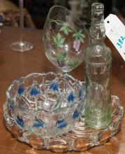 Four items including a glass bowl with tulip design, glass serving dish, and more