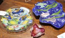 Three decorative bowls with flower and fish motifs and a murano glass ashtray
