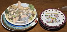 Variety of eight plates in different designs including a wall plaque of a Winter college