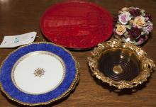 Collection of five items including a cinnabar stlye plate, wine coaster, two decorative plates, and a porcelain floral arrangement