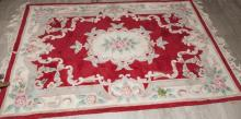 Asian design throw rug with red field
