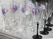 Eight assorted glasses including some from various Planet Hollywood locations