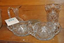 Four pieces of glass (some cut) including sugar and creamer, vase, and cruet