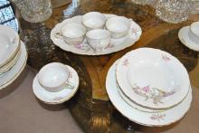 Set of Bohemian dishes, made in Czechoslovakia including cups and saucers, a platter, soup bowls, dinner plates, salad plates, and d...
