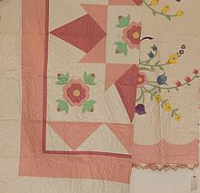 Two vintage American hand sewn quilts, floral aplique, pink borders