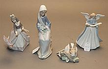 Four Lladro figurines; Girl with Calla Lilies - seated, Girl wit Parasol, Tree-topper Angel and Rabbit Eating