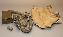 Vintage World War 2 era gas mask in original canvas bag