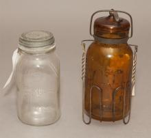 Two American vintage canning jars; Putnam Trade Mark Lighting amber glass jar with iron lock and handled stand, pattent 1886, h: 11 ...