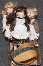 Three porcelain faced dolls, new, in cotton garments