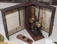 Magic lantern with various glass slides in original case