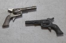 Two miniature metal colt guns, 2 3/4 in.
