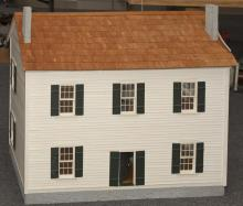 Colonial style wooden doll house, painted, hardwood finished floors