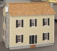 Colonial style wooden doll house, painted, hardwood finished floors, maching window curtains with walls.