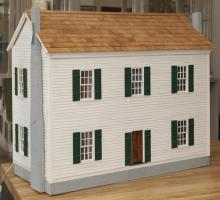 Colonial style wooden doll house, painted, hardwood finished floors.