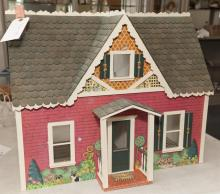 Small country style lithographic paper finish wood dollhouse.