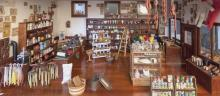 Collection of handmade doll furniture, many items signed, organized as a general store