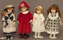 Four modern porcelain dolls with stands