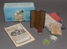 Collection of assorted dollhouse lighting, wax candles, lamps, fabric, ephemera.