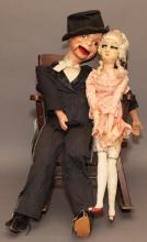 Two vintage dolls: Charlie McCarthy with string to operate his mouth and long-legged boudoir doll, imperfections.