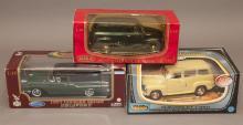 Three American die-cast metal car models, scale 1:18