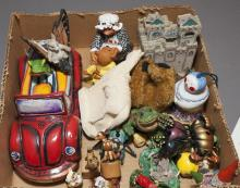 Collection of assorted figurines including hand painted frog driving a car, bears, beetles, etc...
