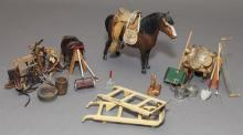 Toy horse, saddle, and gardening equipment