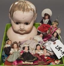 Nine celluloid and plastic dollhouse size dolls in regional costumes, together with composition doll's shoulder-head with set eyes