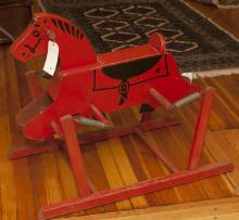 Vintage wooden rocking horse, on base with springs