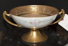 Continental porcelain footed and two handled compote with encrusted gold decoration