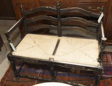 Hitchcock design settee with rush seat and black paint