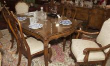 French Louis XV design dining room ensemble comprising a dining table and six chairs, two arms and four sides