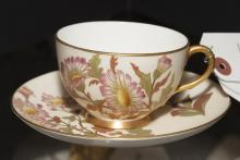 Royal Worcester porcelain cup and saucer, hand painted with gilt decoration