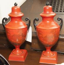 Pair of red colored English urns with outdoor scenes