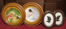 Pair of framed decorative porcelain plates together with a pair of oval framed silhouettes