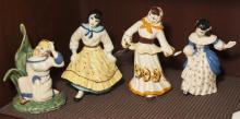 Four ceramic female figurines marked Ceramic Arts Studio - Madison, WI