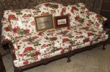 Turn of the 20th century Chippendale design camel-back couch with floral design