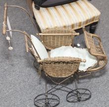 Semi antique wicker doll buggy