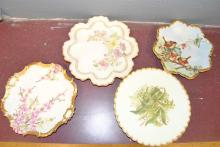 Four finely decorated plates, two stamped France, all with gold gilt trim