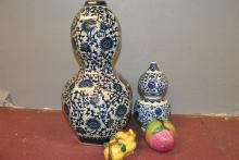Two blue and white Asian design vases together with two porcelain vegetables