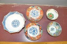 Collection of Asian design plates and bowls - four plates and three bowls